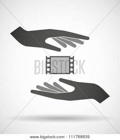 Two Hands Protecting Or Giving A Film Photogram