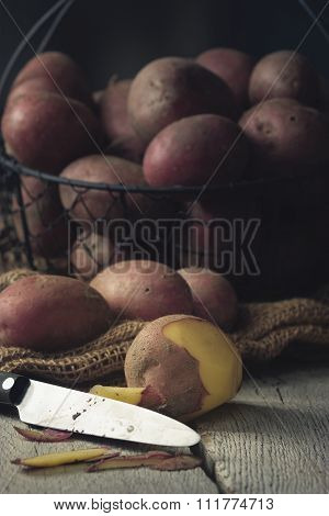 Potatoes in a Basket with Knife