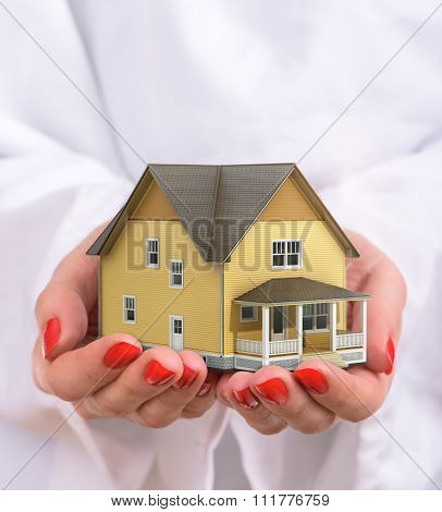 Concept Of Sweet Home Of Dream. Woman Hold House In Hands. Your Property.
