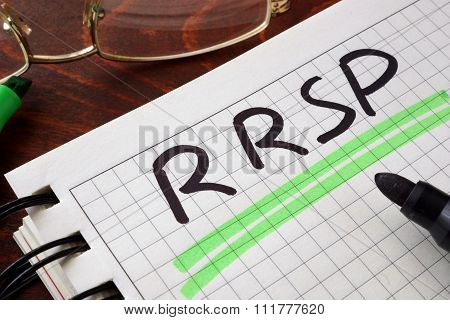 Notebook with RRSP  sign on a table.