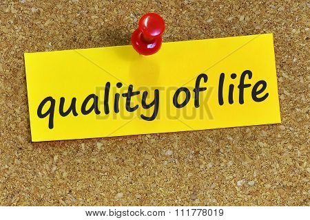 Quality Of Life Word On Yellow Notepaper With Cork Background
