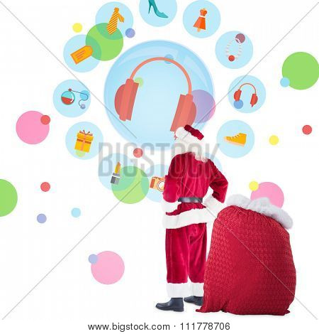 Happy santa with sack of gifts against dot pattern