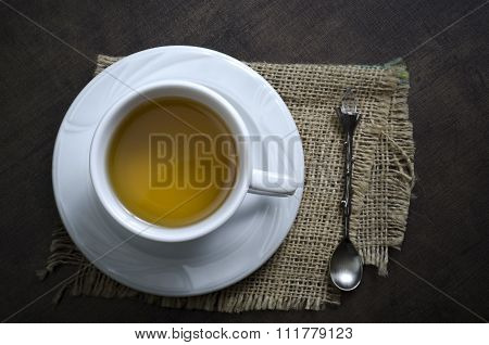 Cup Of Herbal Tea On A Wooden Background