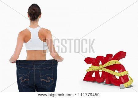 Rear view of a woman who lost a lot of weight against white background with vignette