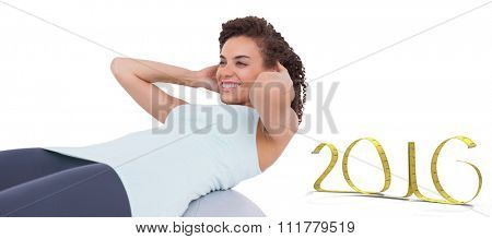 Fit woman doing sit ups against white background with vignette