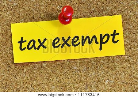 Tax Exempt Word On Yellow Notepaper With Cork Background
