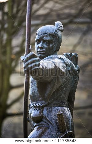 NOTTINGHAM, UK - DECEMBER 04: Statue of Robin Hood outside Nottingham castle. The statue, created by James Woodford, was unveiled in 1952. December 04, 2015 in Nottingham.