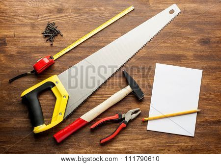 joinery tools on wood table background with note book and copy space
