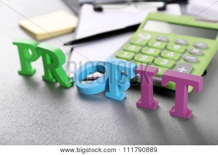 Alphabet Profit and calculator on table