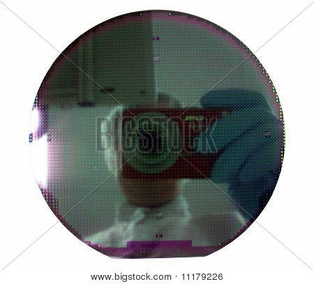 The Person Photographs A Silicon Disk