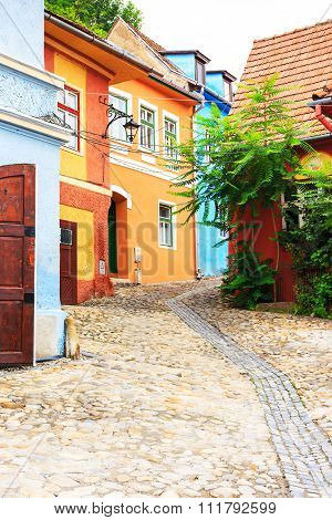 Medieval street view in Sighisoara founded by saxon colonists in XIII century Romania