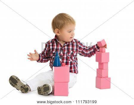 Boy puts pyramid