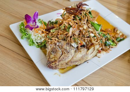 Deep Fried Fish With Herb Salad (thai Dish And Healthy Food)
