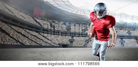 Sportsman running while playing American football against rugby stadium
