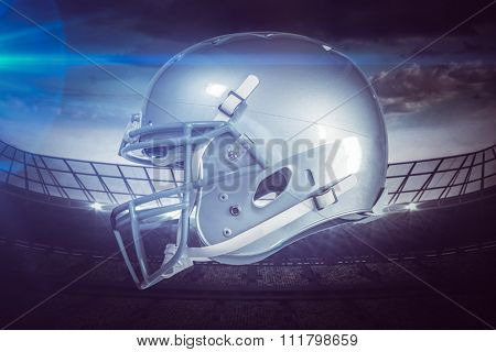 American football helmet against rugby stadium