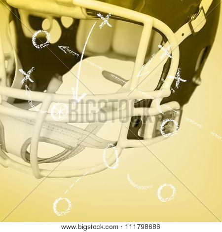 An american football helmet on the field against yellow vignette
