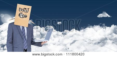 Anonymous businessman against night sky