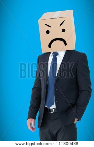 Anonymous businessman against blue background with vignette
