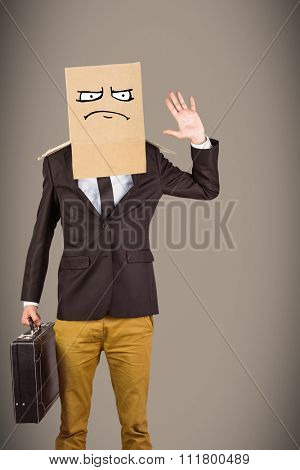 Anonymous businessman against grey background with vignette
