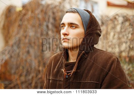Guy In A Knitted Cap And Fashionable Jacket