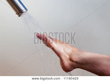 girl's foot and water jet