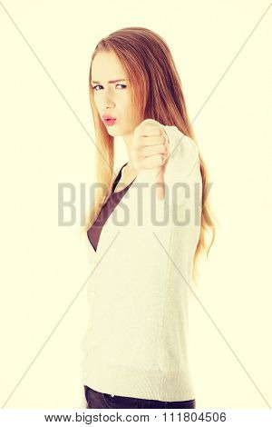 Young blonde woman with thumb down.