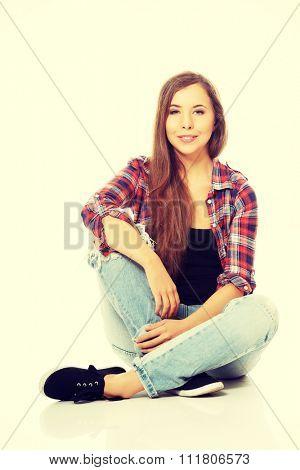 Happy smiling woman sitting cross-legged