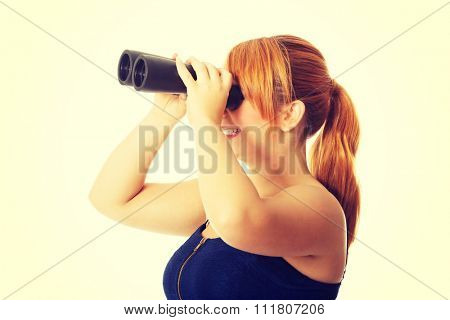 Overweight woman seeking with binocular.
