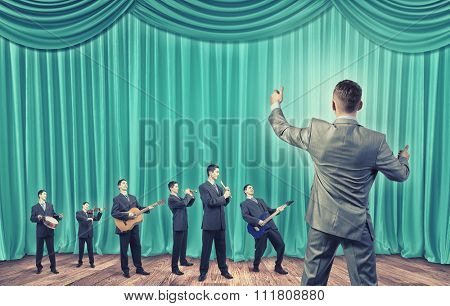 Man orchestra in suit playing different music instruments