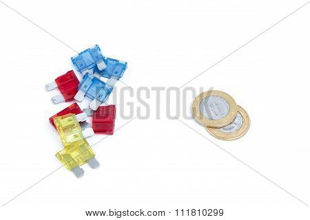 Car Fuse. Brazilian Currency And Pile Of Colorful Electrical Automotive Fuses Or Circuit Breakers Is