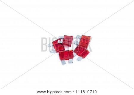 Car Fuse. Pile Of Red Electrical Automotive Fuses Or Circuit Breakers Isolated On White Background