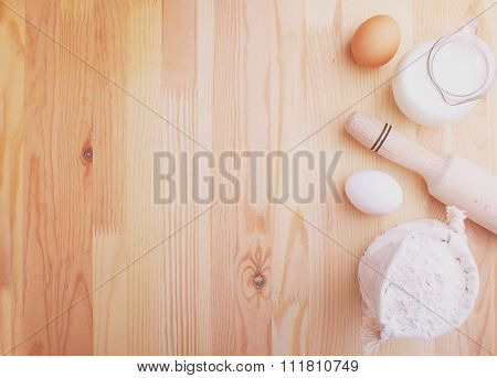 Eggs Flour Milk And Whisk On A Wood Background