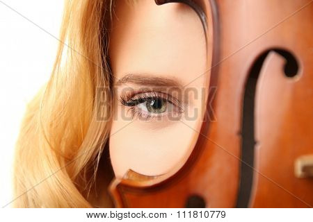 Young beautiful woman with violin against white background, close up