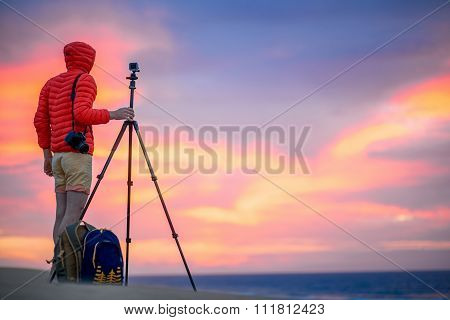 Photographer working outside in the early morning