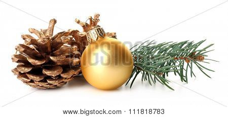 Golden Christmas ball with pine and cone isolated on white background