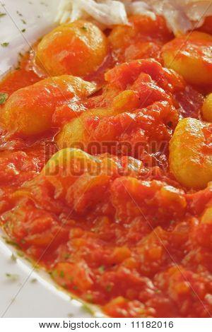 Italian potato gnocchi with Mediterranean tomato sauce