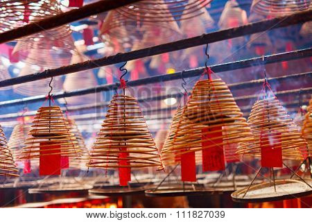 Circular incenses burning in Man Mo Temple, Hong Kong, China