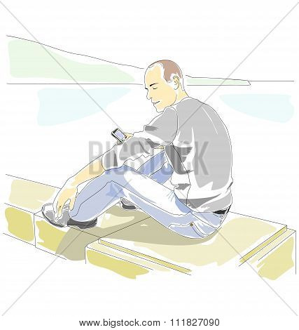 Man with mobile phone sitting on the parapet