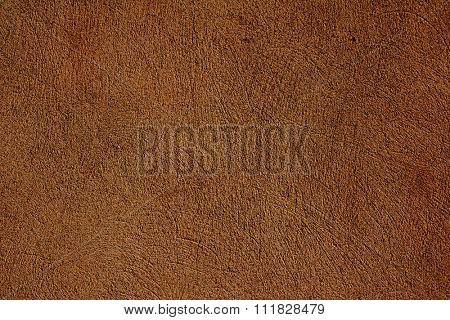 Grunge background with texture of old stucco of brown color