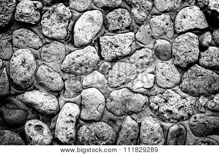 Texture Of Gray Stone Coquina Wall In Cement High Contrasted With Vignetting Effect