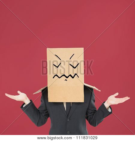 Shrugging businessman against red