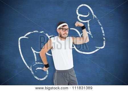 Geeky hipster posing in sportswear against blue chalkboard