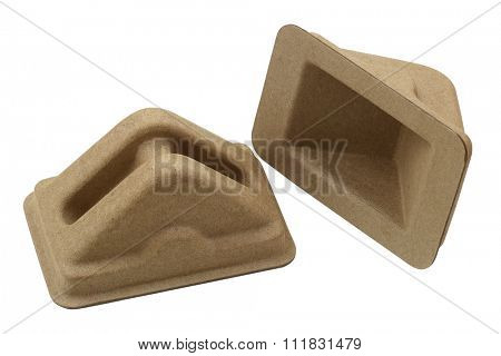 Closeup of packing material - corner and edge protector during the shipping delivery made of molded paper, isolated on white background
