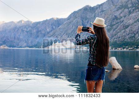Girl Taking Photo Of Cruise Liner