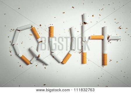 Broken cigarettes arranged as a word quit