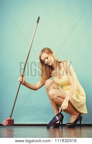 Elegant Woman Sweeping Floor With Broom