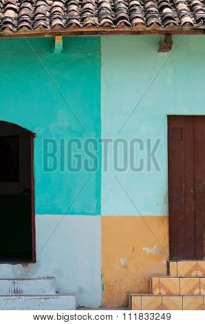 Two doors with colorful walls in central america