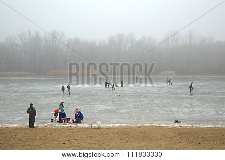 TISZAFURED, HUNGARY - DECEMBER 28: People skating on the frozen Lake Tisza on December 28, 2014 in Tiszafured, Hungary.