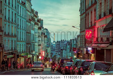 Impressive parisian city street scene with Eiffel Tower in the background