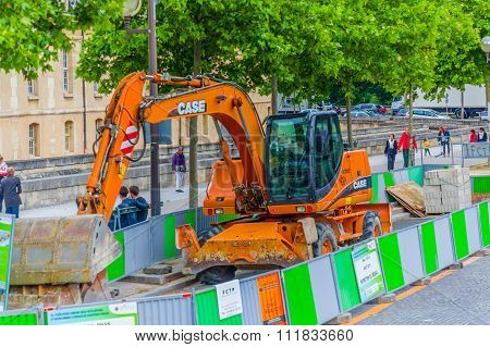 Excavator in a contruction site, Paris, France